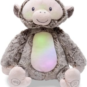 Mono de peluche con luces y sonidos relajantes.